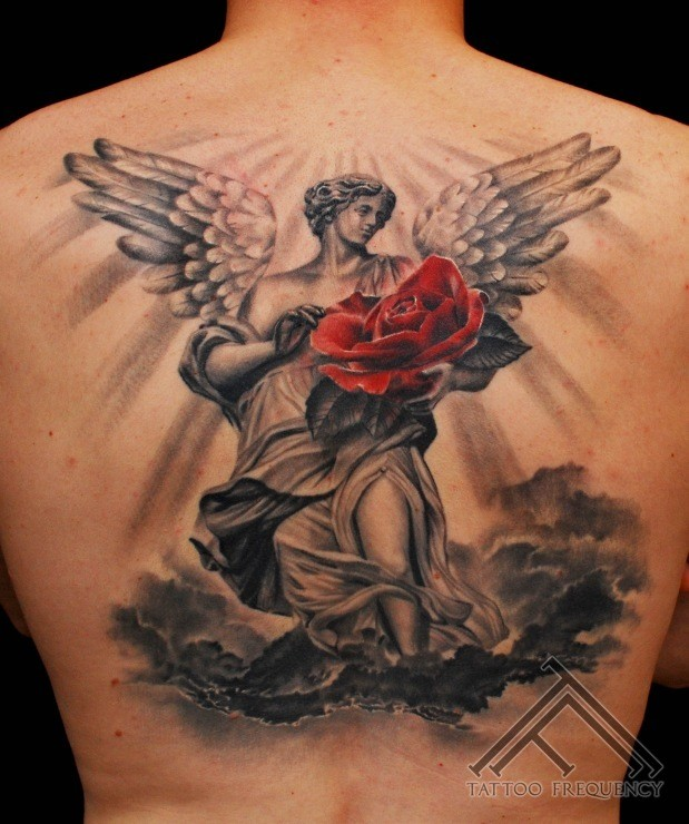 Large black and white angel statue with red rose