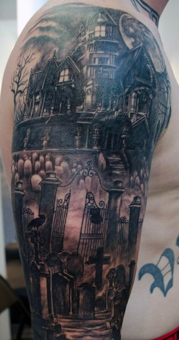Large black and white horror style shoulder tattoo of old abandoned house with cemetery