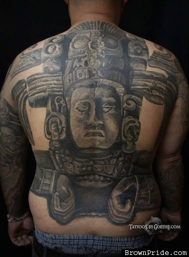 Large black and white whole back tattoo of stone statue