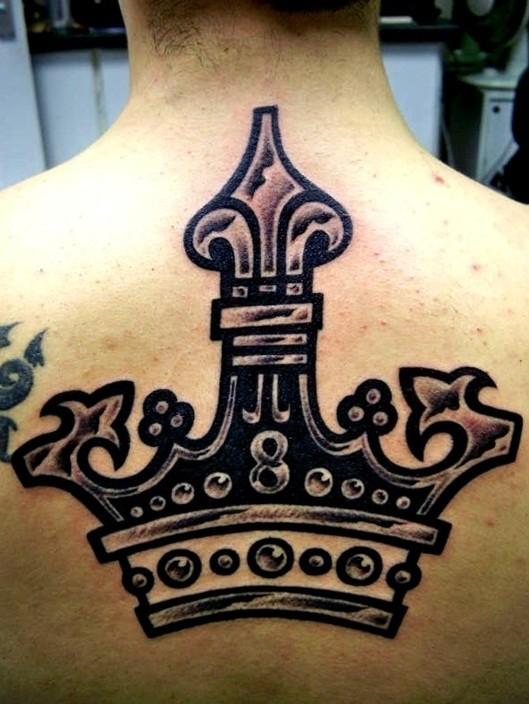 Large black crown tattoo on back
