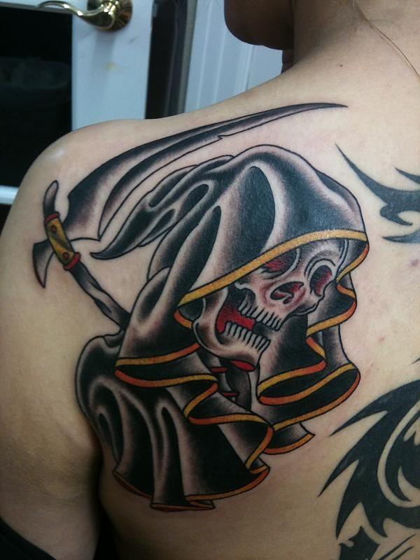 Large black death tattoo on back