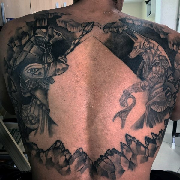 Large black ink back tattoo of various Egypt Gods