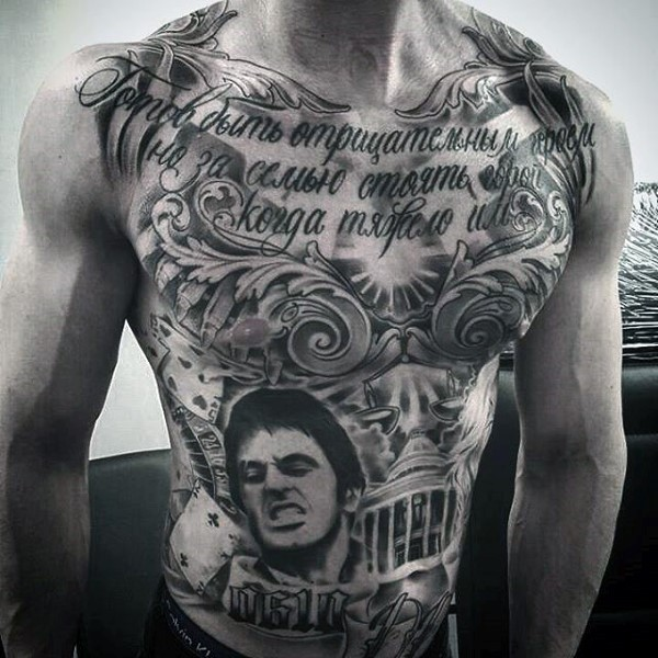 Large black ink chest and belly tattoo of lettering and God father