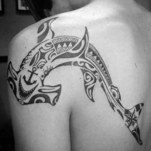 Large black ink Polynesian style shoulder and back tattoo of hammerhead shark stylized with anchor and star