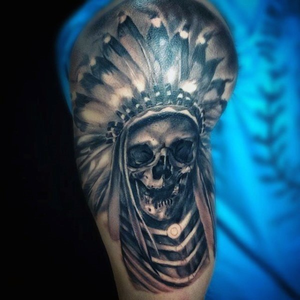 Large black ink shoulder tattoo of Indian skeleton