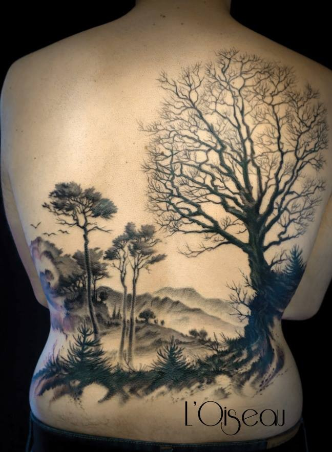 Large black ink whole back tattoo of big forest