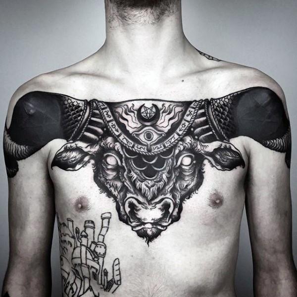Large blackwork style mystical chest tattoo of big demonic bulls head stylized with cult symbol
