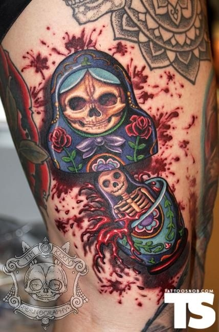 Large bloody looking thigh tattoo of Matryoshka doll with skeleton