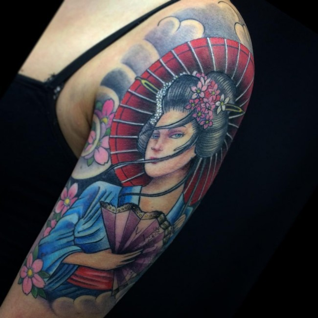 Large colored shoulder tattoo of Asian woman with umbrella