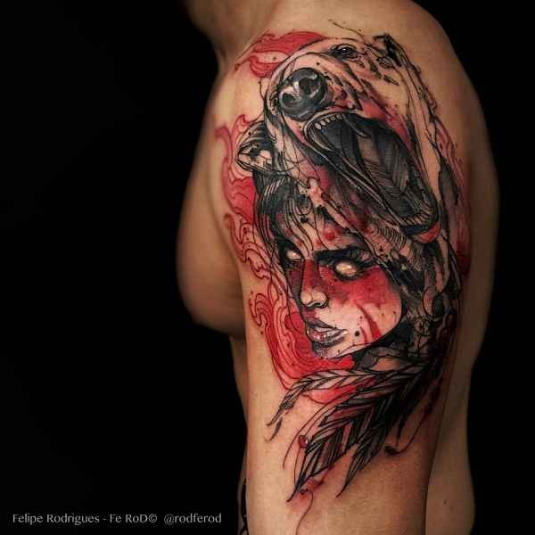 Large colored shoulder tattoo of bloody woman with bear