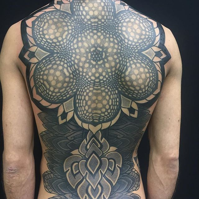 Large colored whole back tattoo of incredible ornamental flower