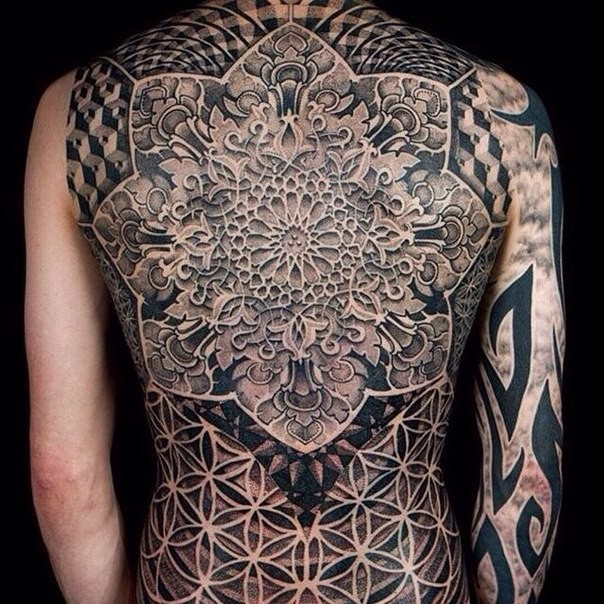 Large colored whole back tattoo of large ornamental flower