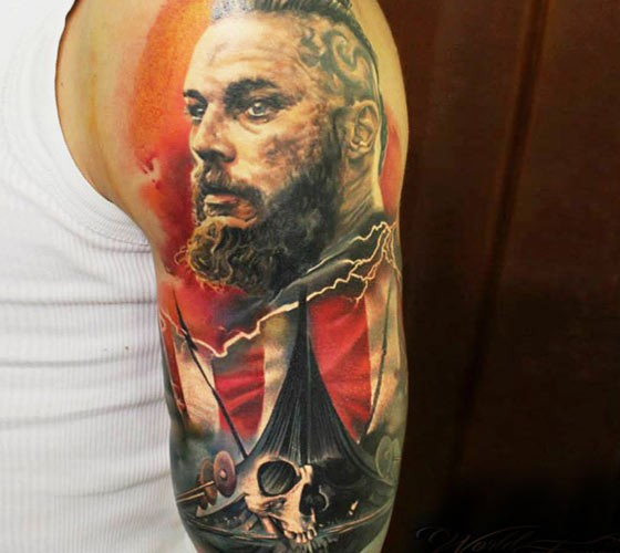 Large colorful shoulder tattoo of Viking with ship