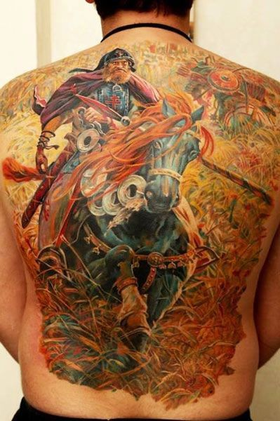 Large colorful warrior on a horse with red mane tattoo on  back