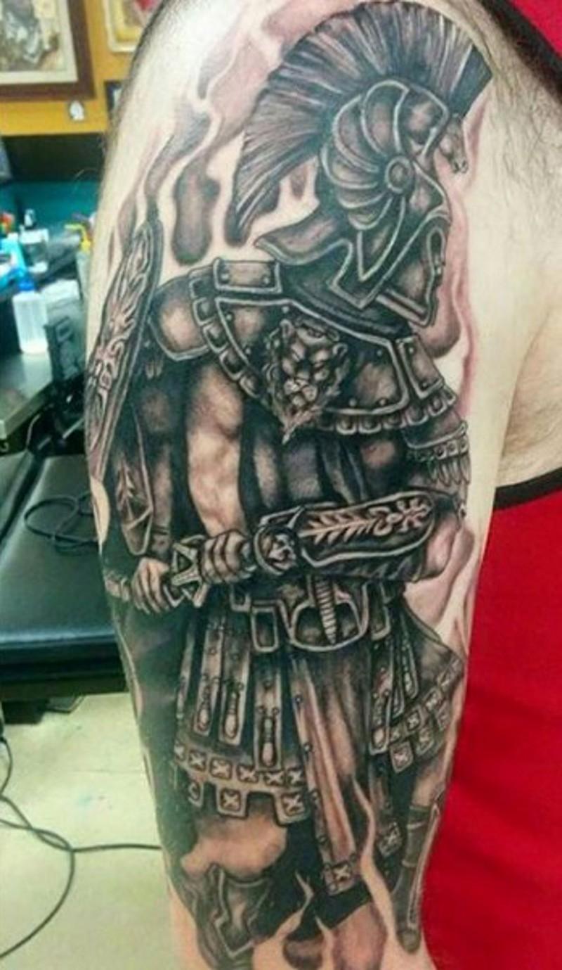 Large detailed black and white shoulder tattoo of antic gladiator warrior