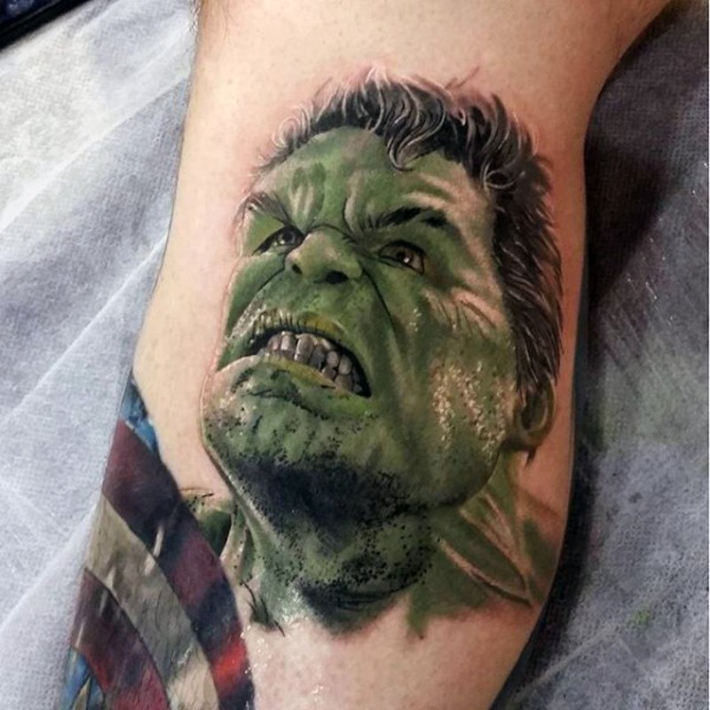 Large detailed colored leg tattoo of angry Hulk portrait