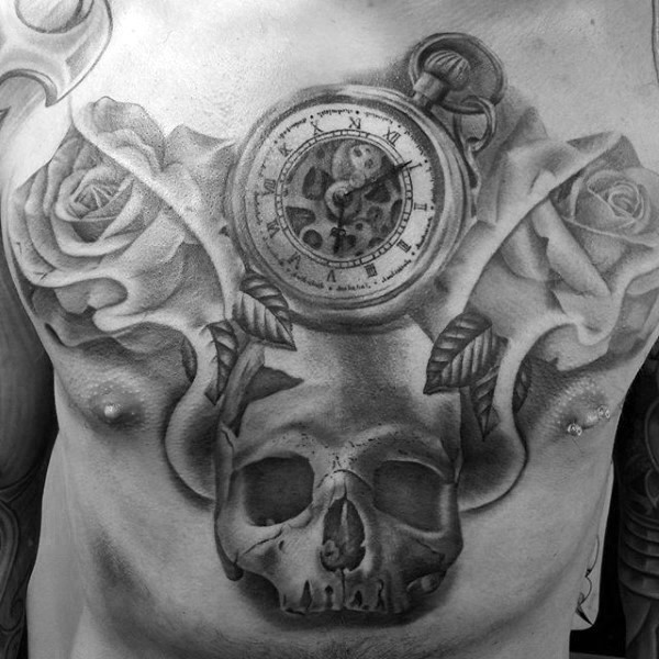 Large gray washed style whole chest tattoo of human skull with compass and flowers