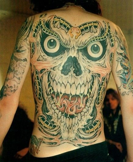 Large grinning demon tattoo on whole back