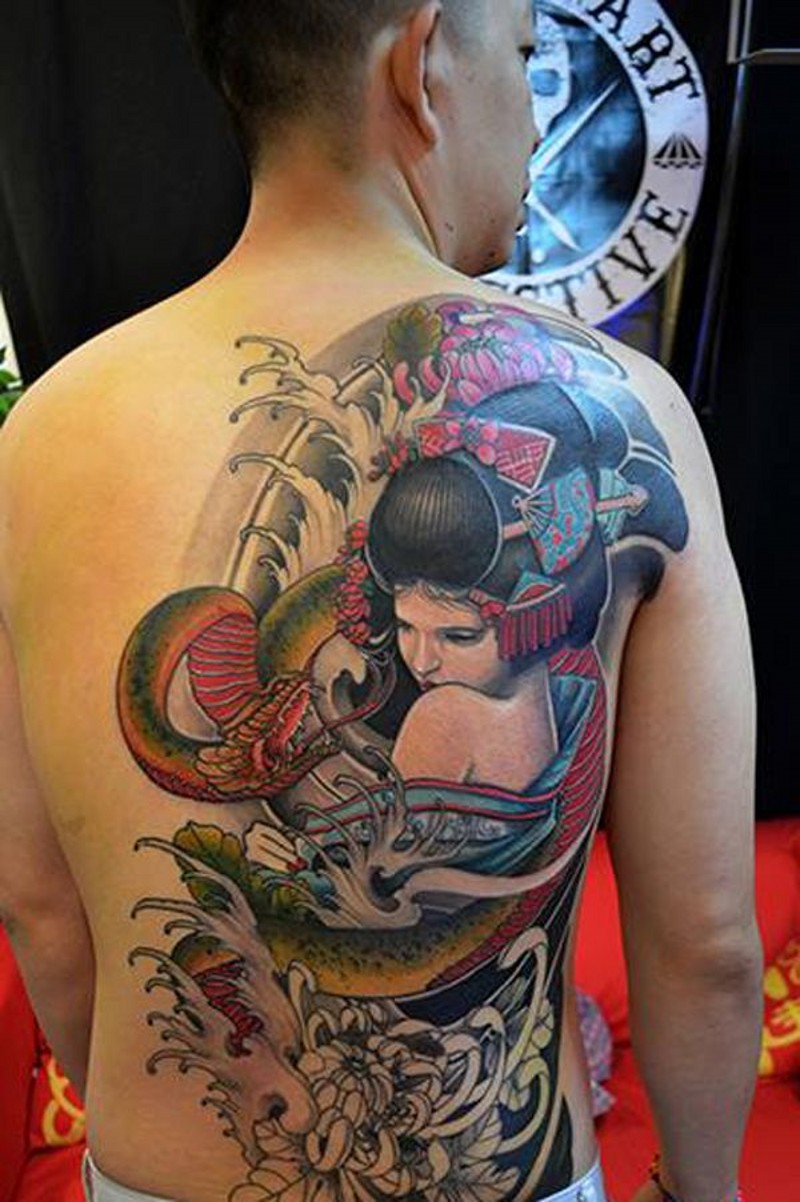 Large half colored half back tattoo of geisha with flowers and snake