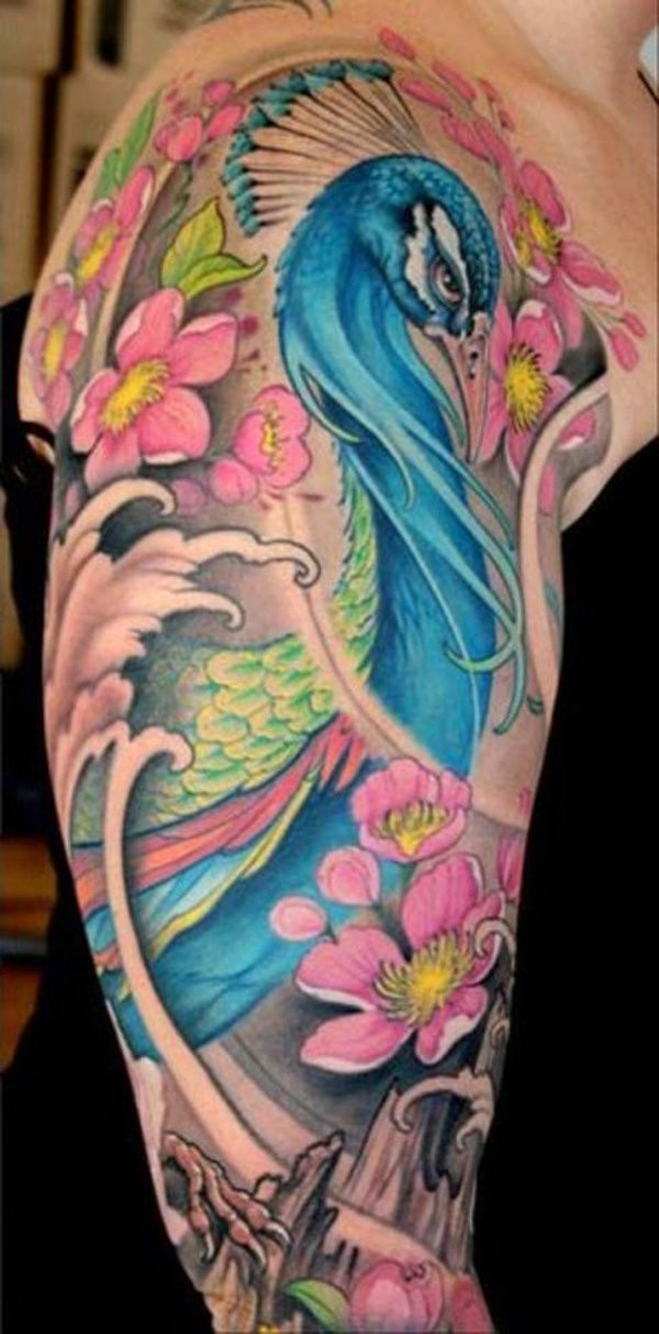 Large illustrative style colored shoulder tattoo of peacock with flowers