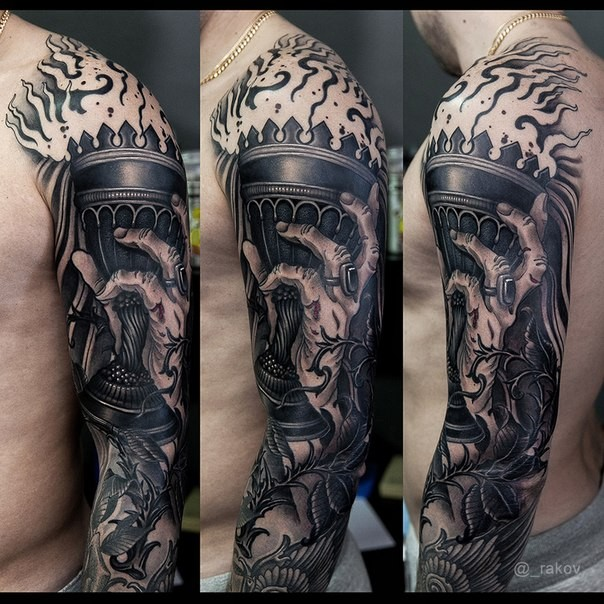 Large illustrative style colored sleeve tattoo of creepy hand with torch