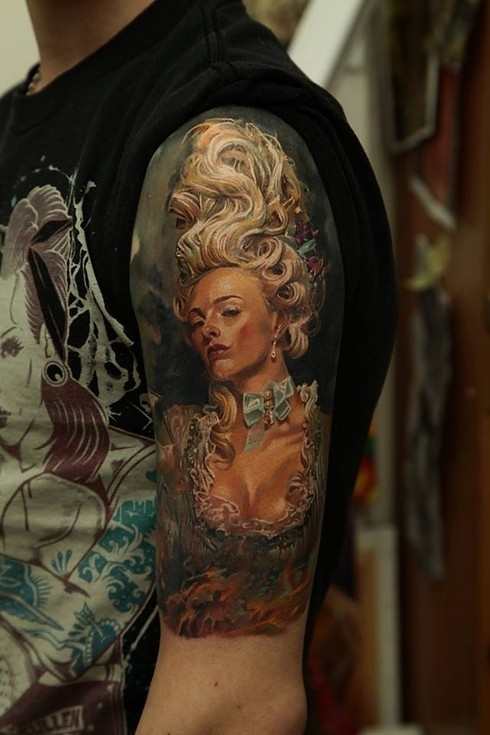 Large illustrative style shoulder tattoo of sexy medieval woman