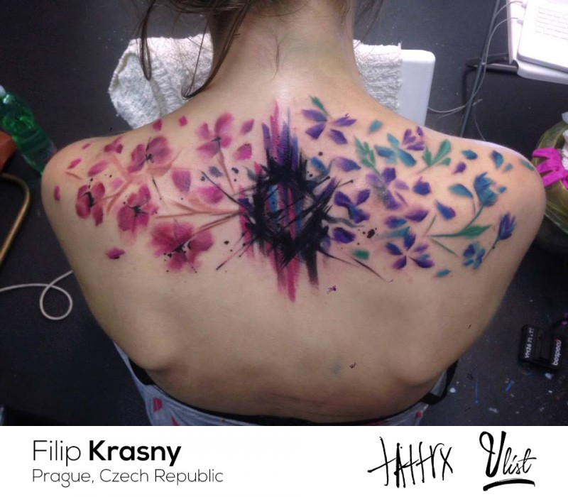 large illustrative style upper back tattoo of various flowers