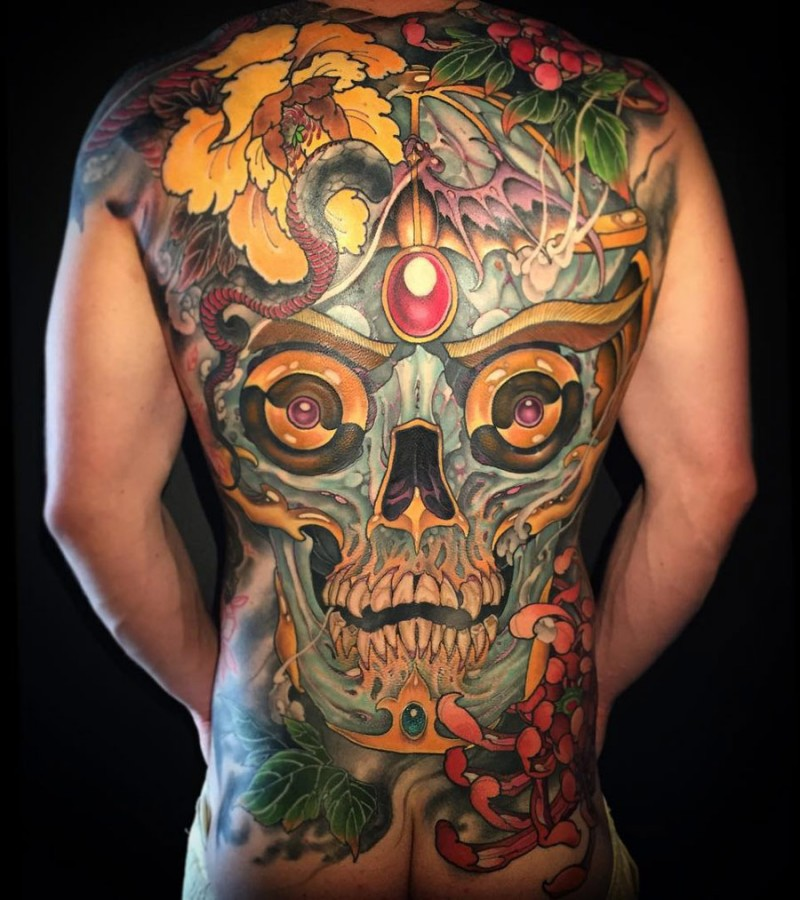 Large illustrative style whole back tattoo of magical human skull with snake