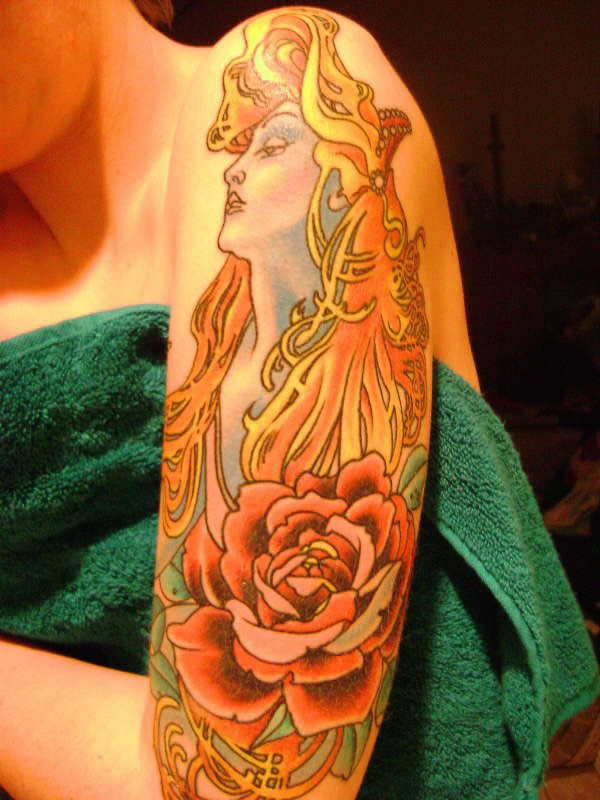 Large interesting looking illustrative style shoulder tattoo of woman with rose flower