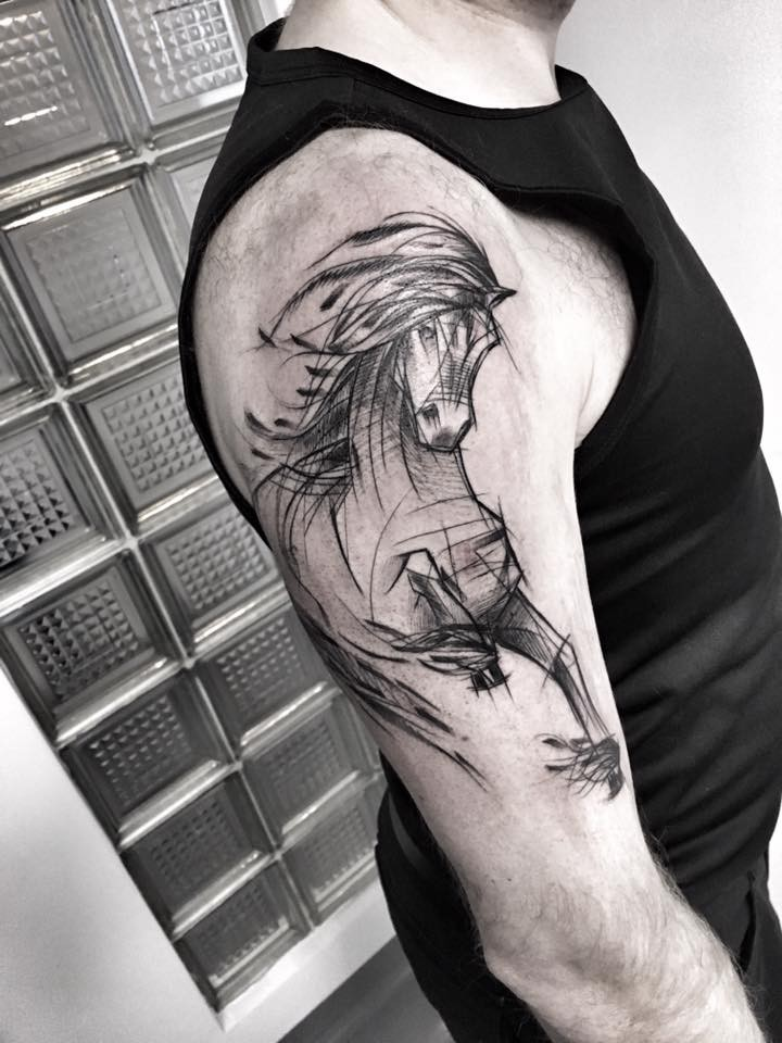 Large linework style upper arm tattoo by Inez Janiak of running horse