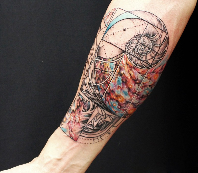 Large multicolored arm tattoo of mysterious ornaments