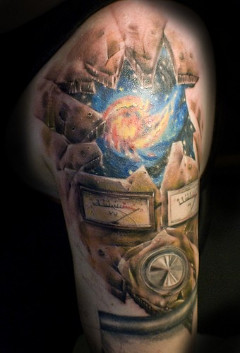 Large multicolored shoulder tattoo of broken dials and space