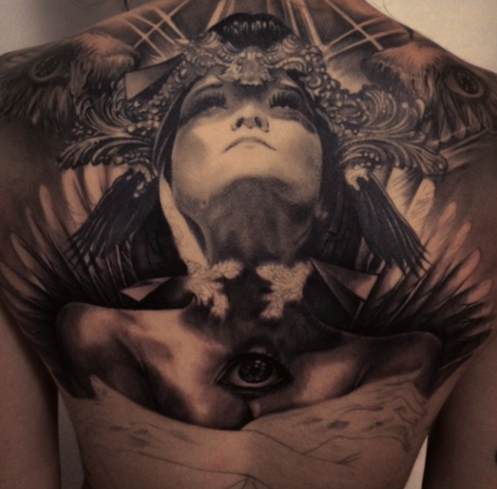 Large mystical back tattoo of ancient woman with pyramids and eye