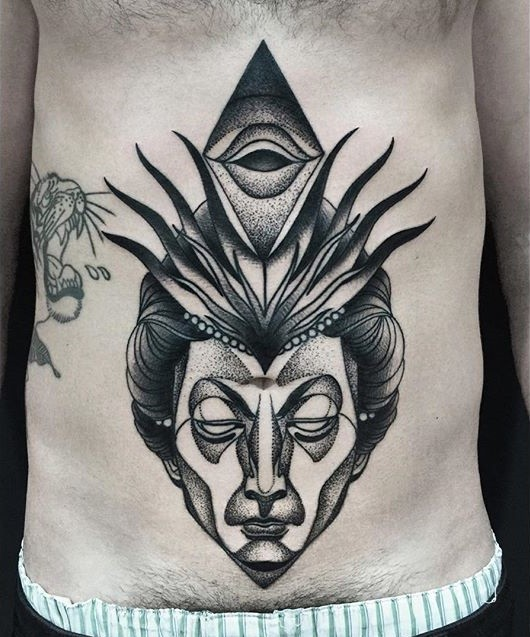 Large mystical blackwork style painted by Michele Zingales belly tattoo of human head