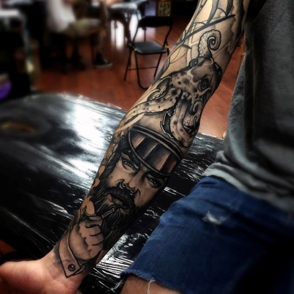 Large nautical themed black and white tattoo with sailor and octopus on sleeve