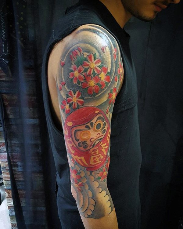 Large neo japanese style colored sleeve tattoo of daruma doll with waves and flowers