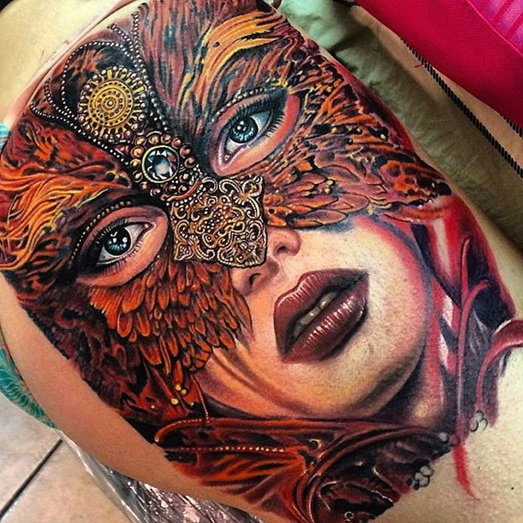 Large nice looking tattoo of beautiful woman face stylized with gorgeous mask