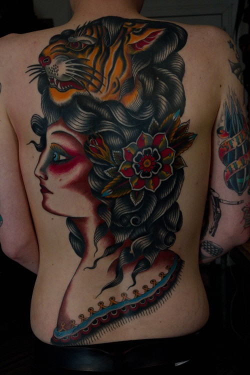 Large old school style colored whole back tattoo of woman face with tiger face and flower