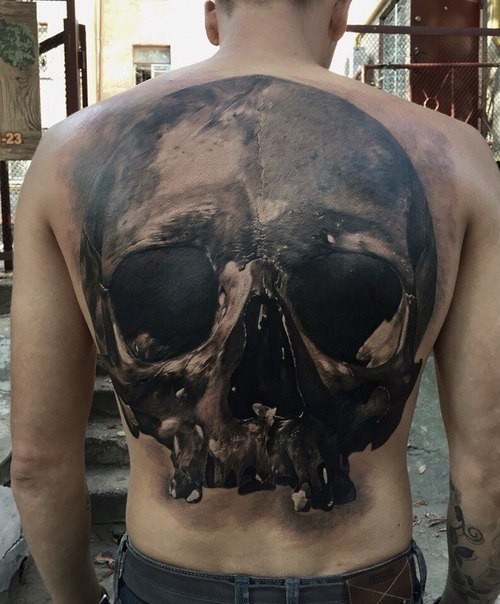 Large realism style black and white back tattoo of human skull