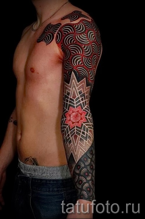 Large stippling style colored sleeve and shoulder tattoo of various ornaments