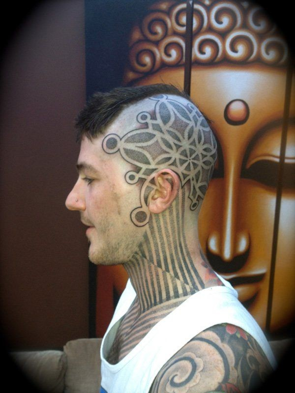 Large stippling style head and neck tattoo of original ornament