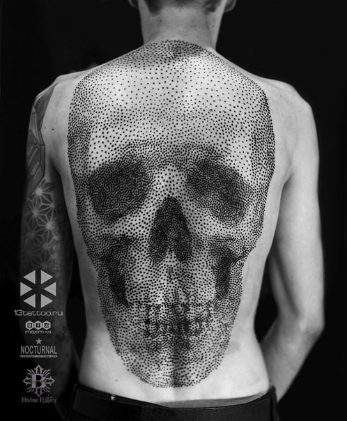 Large stippling style whole back tattoo of human skull