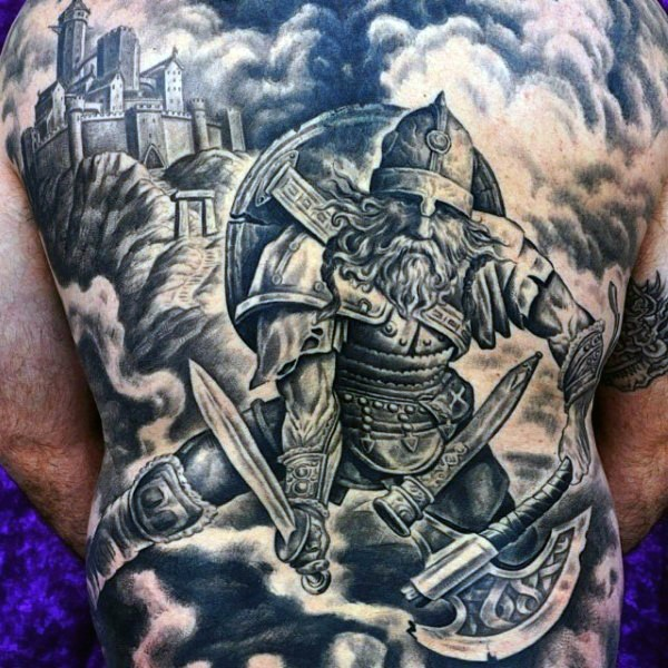 Large very detailed whole back tattoo of medieval warrior with castle