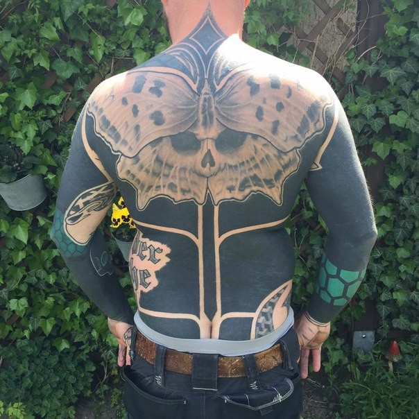 Large whole back tattoo of large butterfly