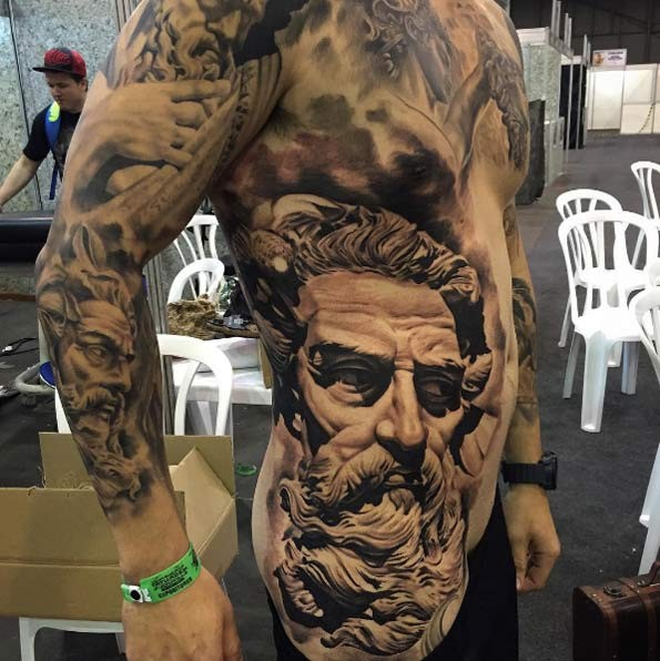 Large whole body tattoo of ancient stone statues