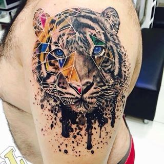 Lifelike accurate looking shoulder tattoo of tiger portrait with geometrical figures
