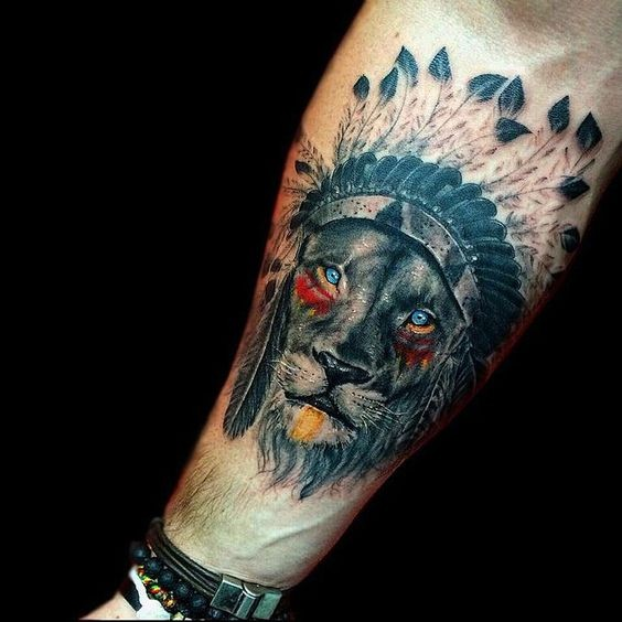 Lifelike amazing looking colored forearm tattoo of Indian like lion with helmet