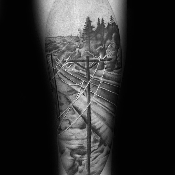 Lifelike black ink shoulder tattoo of old electricity line tower with road