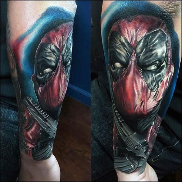 Lifelike colored arm tattoo of evil Deadpool and pistol