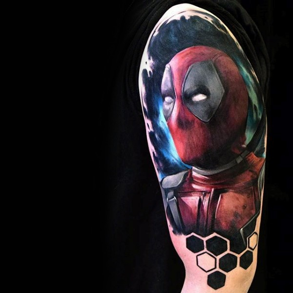 Lifelike colored shoulder tattoo of Deadpool with ornaments